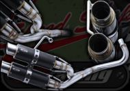 Exhaust. Carbon fibre. MARKS Performance. Single side Twin system. Suitable for use with Monkey style bikes.