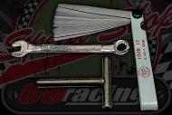 Tool kit for setting valve clearances.