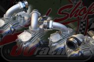 Manifold. 26/28mm. Multi fitting options. Suitable for use with  HONDA OR KLX port. Bolt on or push fit. Swivel fitment
