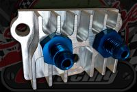 This is a nicely made CNC billet take off anodized silver with Blue AN4 fast flow tails