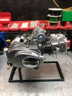130cc YX Manual engine  4 speed primary clutch top mounted electric start.